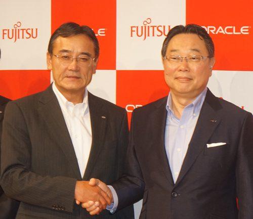 富士通の山本正巳会長と日本オラクルの杉原博茂社長