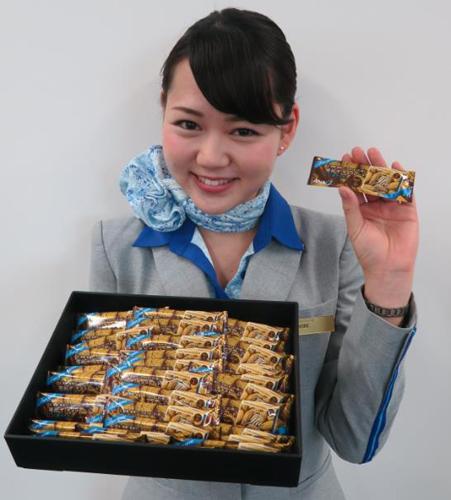 「明治 ザ・チョコレート」を機内でプレゼント